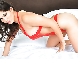 Woman in red Sunny Leone strips for your viewing pleasure